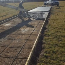 Finally our new concrete cricket pitch is being poured.